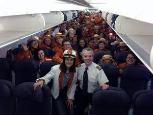 Mary Gilstad '15, Michael Niggemann Niemann '90, and the Princeton Band at large pose for a photo on the plane home.