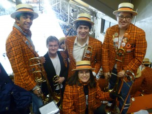 The trombone section bundles up for a hockey game at Baker Rink